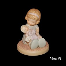 Vintage Enesco Memories of Yesterday Wrapped in Love and Happiness Figurine