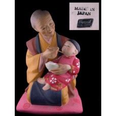 Hakata Urasaki Doll - Woman Feeding Child