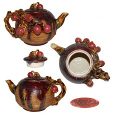 Majolica-like Teapot Draped with Red Fruit